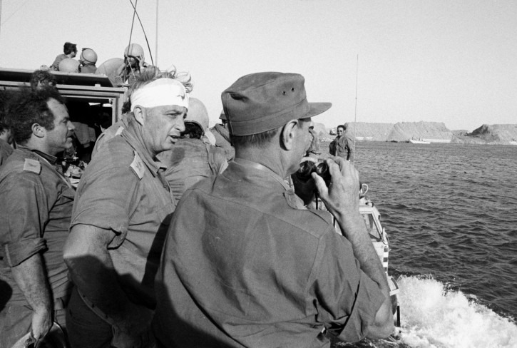 A handout photograph supplied by the Israeli Ministry of Defense on 11 January 2014 shows a young General Ariel (Arik) Sharon (2-L) with his head wrapped in a bandage as he speaks with with Defense Minister Moshe Dayan (R) and other unidentified army officers while on a boat on the Suex Canal during Israel's Six Day War in June 1967. Sharon was wounded on his head when he collided with a tank turret in the Egyptian Sinai campaign. Former Israeli Prime Minister Sharon, who had been in a coma after suffering a stroke and brain haemorrhage on 04 January 2006 while campaigning for re-election, died on 11 January 2014 at the age 85.  EPA/MINISTRY OF DEFENSE/HANDOUT  HANDOUT