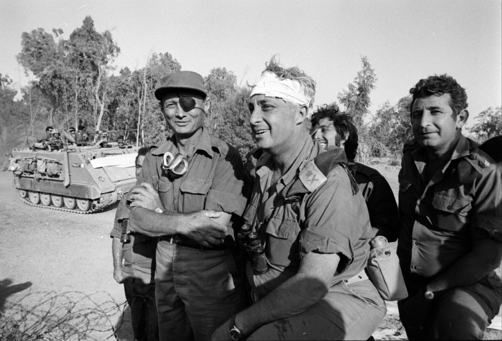 A handout photograph supplied by the Israeli Ministry of Defense on 11 January 2014 shows a young General Ariel (Arik) Sharon (C) with his head wrapped in a bandage as he stands with Defense Minister Moshe Dayan (L) and other unidentified army officers in an undisclosed location during Israel's Six Day War in June 1967. Sharon was wounded on his head when he collided with a tank turret in the Egyptian Sinai campaign. Former Israeli Prime Minister Sharon, who had been in a coma after suffering a stroke and brain haemorrhage on 04 January 2006 while campaigning for re-election, died on 11 January 2014 at the age 85.  EPA/MINISTRY OF DEFENSE/HANDOUT