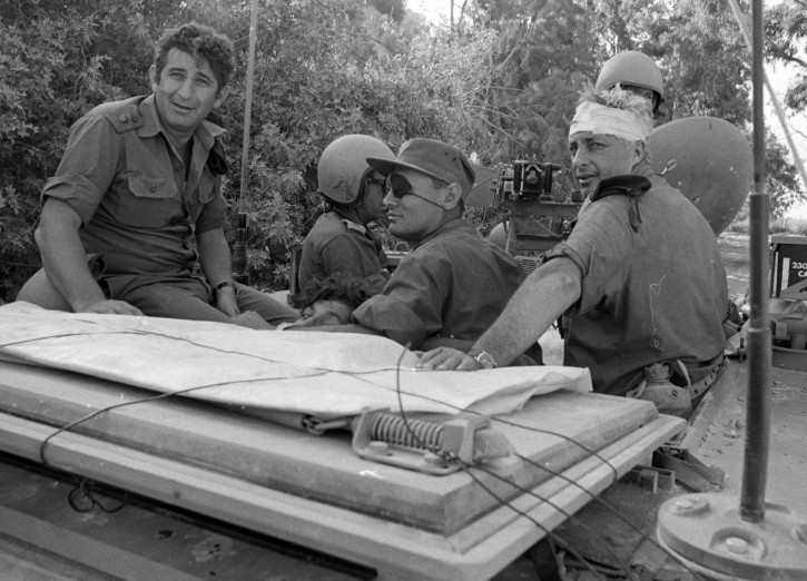 A handout photograph supplied by the Israeli Ministry of Defense on 11 January 2014 shows a young General Ariel (Arik) Sharon (R) with his head wrapped in a bandage with Defense Minister Moshe Dayan (C) and other unidentified army officers in an undisclosed location during Israel's Six Day War in June 1967. Sharon was wounded on his head when he collided with a tank turret in the Egyptian Sinai campaign. Former Israeli Prime Minister Sharon, who had been in a coma after suffering a stroke and brain haemorrhage on 04 January 2006 while campaigning for re-election, died on 11 January 2014 at the age 85.  EPA/MINISTRY OF DEFENSE/HANDOUT  HANDOUT