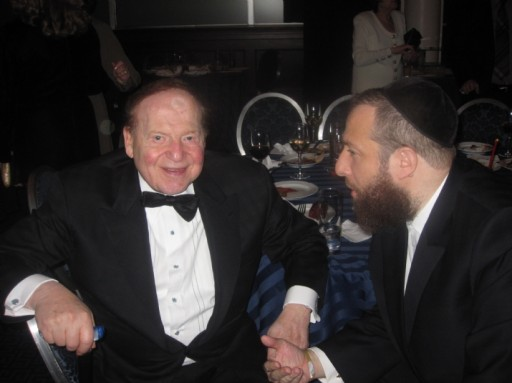FILE - Ezra Friedlander, CEO The Friedlander Group in a discussion with Sheldon Adelson. Adelson is one of the biggest financial supporters of Birthright