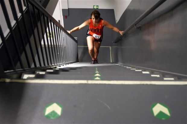 A competitor makes her way up during the Empire State Building Run-Up Wednesday, Feb. 5, 2014, in New York. (AP Photo/Jason DeCrow)