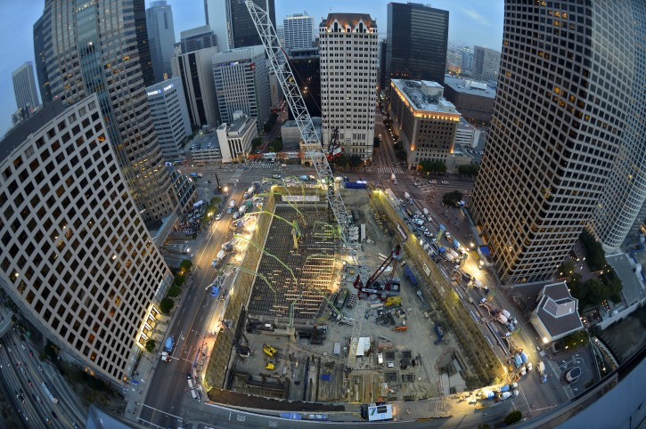 In this Ariel photo made with a fisheye lens, crews pour concrete to lay the foundation for the New Wilshire Grand building in a record attempt for the largest continuous concrete pour in history, Saturday, Feb. 15, 2014, in downtown Los Angeles. The marathon pour is expected to last 20 hours without interruption. The attempt will be verified by an official from Guinness World Records. The New Wilshire Grand will be the tallest building to be built west of the Mississippi and is expected to be completed in 2017. (AP Photo/Mark J. Terrill)