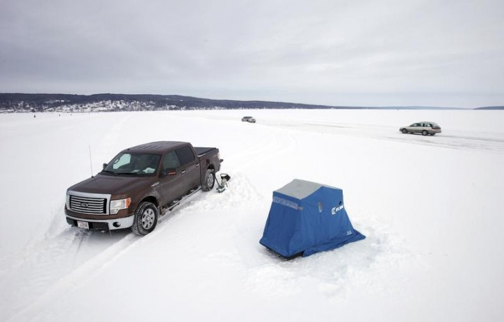 Cornucopia wi in photos winter builds rare icy path to for Lake superior ice fishing