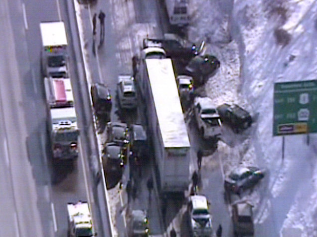 This video frame grab provided by Fox 29 Philadelphia shows traffic accidents involving multiple tractor trailers and dozens of cars on Pennsylvania Turnpike outside Philadelphia, on Friday, Feb. 14, 2014.  The crashes were reported just after 8 a.m. Friday, one day after the area got about a foot of snow that left roads slick. Television news helicopter footage showed several tractor-trailers and dozens of cars involved in a series of accidents that had backed up traffic for miles between the Bensalem and Willow Grove exits. (AP Photo/Fox 29 Philadelphia)