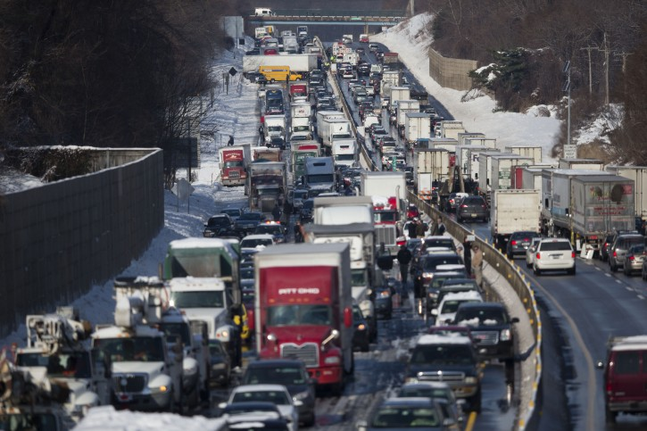 Vehicles are piled up in an accident Friday, Feb. 14, 2014, in Bensalem, Pa. Traffic accidents involving multiple tractor trailers and dozens of cars have completely blocked one side of the Pennsylvania Turnpike outside Philadelphia and caused some injuries. (AP Photo/Matt Rourke)