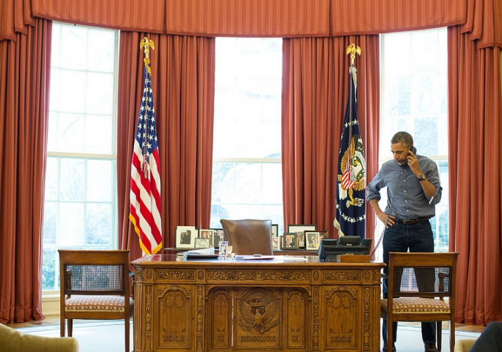 President Barack Obama talks on the phone in the Oval Office with Russian President Vladimir Putin about the situation in Ukraine, March 1, 2014.<br /> (Official White House Photo by Pete Souza)