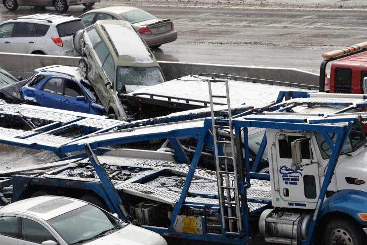 Emergency workers respond to a massive pileup accident on Interstate 25 in Denver, Saturday, March 1, 2014. Authorities say one person was killed and 30 others were injured in the giant pileup. (AP Photo/The Denver Post, Hyoung Chang)