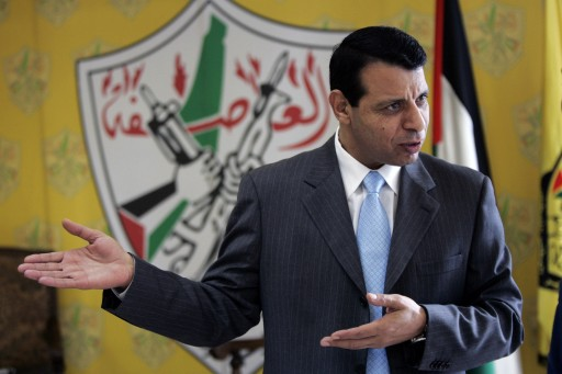 In this Jan. 3, 2011 file photo, Palestinian Fatah leader Mohammed Dahlan gestures as he speaks during an interview with The Associated Press in his office in the West Bank city of Ramallah. (AP Photo/Majdi Mohammed, File)