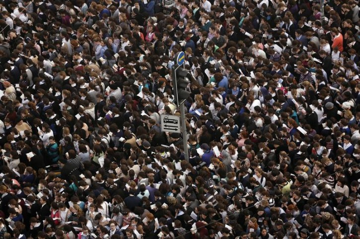 Ultra-Orthodox Jewish women take part in a mass prayer in Jerusalem March 2, 2014. Hundreds of thousands of ultra-Orthodox Jews held a mass prayer in Jerusalem on Sunday in protest against a bill meant to slash military exemptions granted to seminary students, a tradition held since the founding of Israel. REUTERS/Darren Whiteside (