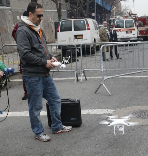 A camera drone flown by Brian Wilson lands near the scene where two buildings were destroyed in an explosion, in the East Harlem section in New York City, March 12, 2014. Two New York buildings collapsed on Wednesday in an explosion believed to be caused by a gas leak, killing two people, injuring at least 22, and setting off a search for more feared trapped in the debris, officials said.  REUTERS/Mike Segar