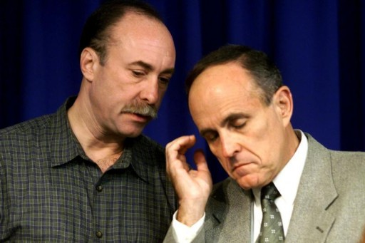 FILE - Former New York City Mayor Rudy Giuliani (R) confers with the Former Director of the Mayor's office of Emergency Management Jerry Houer October 31, 1999. Reuters