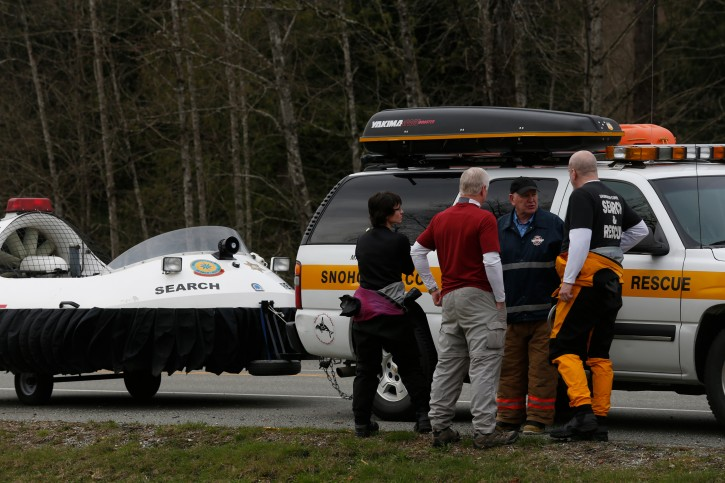 Search and Rescue personnel gather near the site of a fatal mudslide near Oso, Wash., Saturday, March 22, 2014. (AP Photo /The Daily Herald, Annie Mulligan)
