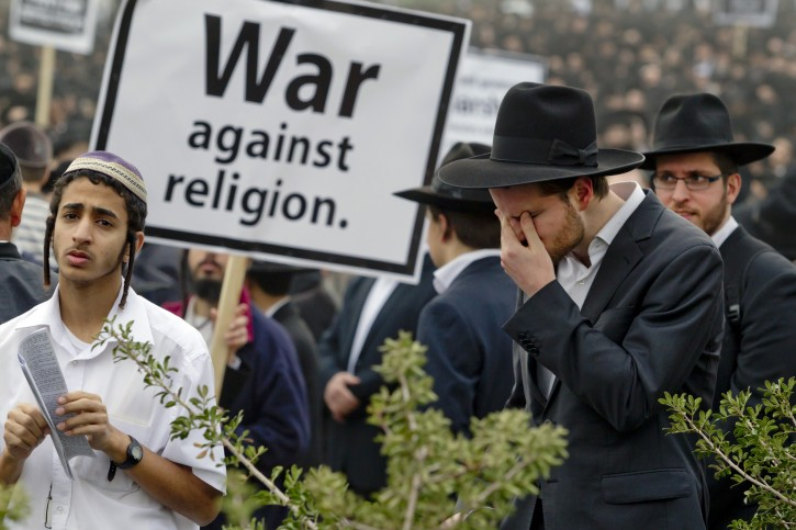 FILE -  Ultra-Orthodox Jews gather for a mass prayer in protest to the government's army conscription laws in Jerusalem, 02 March 2014. EPA