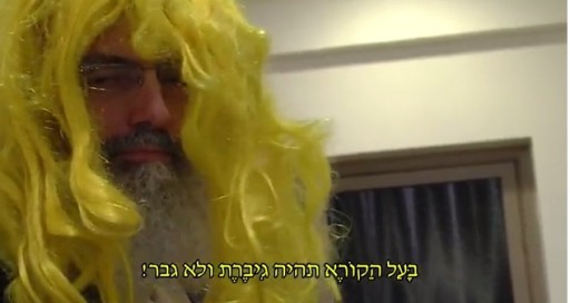 Image grab from You-tube clip where Rabbi Stav is dressed with a color wig