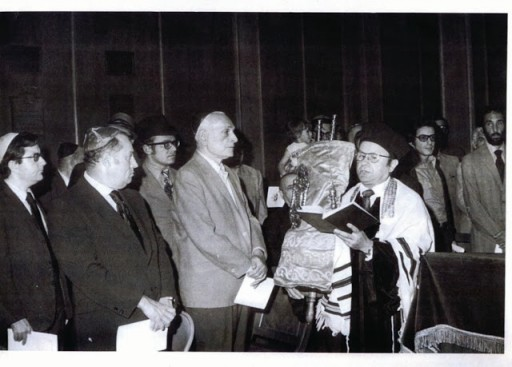 Rav Dovid at holding the Torah and singing at a hachnasas sefer Torah in 1955