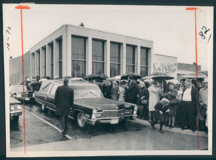 1969 FILE - A somber crowd gathers near a hearse carrying the body of Esther Lebowitz in 1969. (Photo by Baltimore Sun Courtesy to VINnews.com)