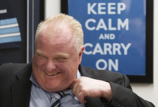 "FILE- Toronto Mayor Rob Ford laughs in front of a ""Keep Calm and Carry On"" sign at City Hall in Toronto March 19, 2014. Reuters"