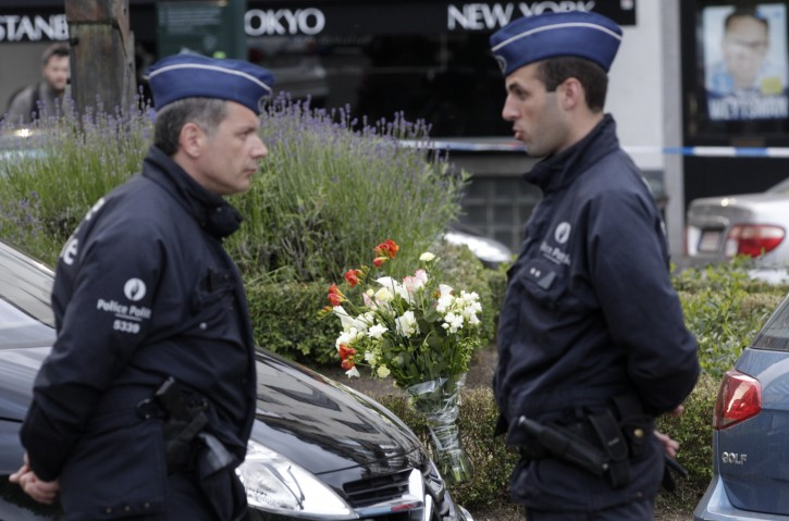 Some flowers were put close to the site of a shooting at the Jewish museum in Brussels, Saturday, May 24, 2014.  AP