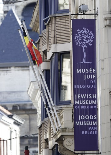A banner shows the facade of the Jewish museum, the site of a shooting in Brussels, Saturday, May 24, 2014. AP