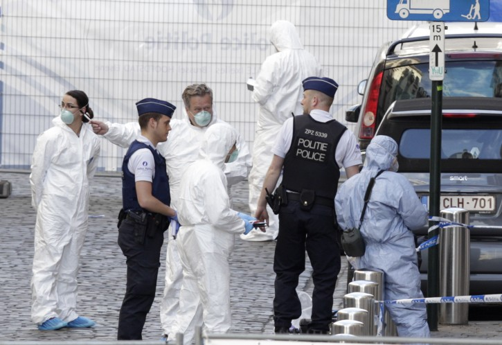 Forensic experts examine the site of a shooting at the Jewish museum in Brussels, Saturday, May 24, 2014.  EPA