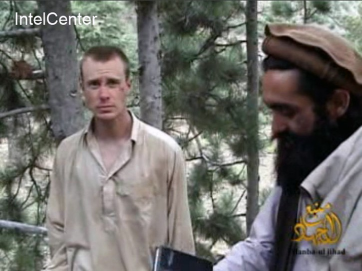 FILE - This file image provided by IntelCenter on Dec. 8, 2010, shows a frame grab from a video released by the Taliban containing footage of a man believed to be Bowe Bergdahl, left.  Saturday, May 31, 2014, U.S. officials say Bergdahl, the only American soldier held prisoner in Afghanistan has been freed and is in U.S. custody. The officials say his release was part of a negotiation that includes the release of five Afghan detainees held in the U.S. prison at Guantanamo Bay, Cuba. (AP Photo/IntelCenter, File)