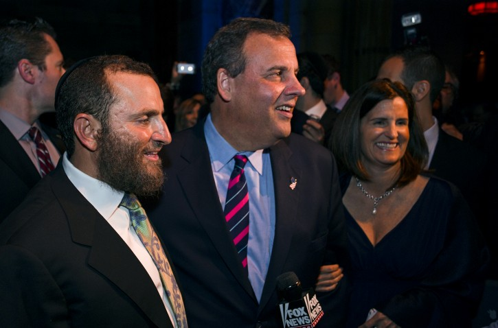 New Jersey Gov. Chris Christie, center, walks with Rabbi Shumley Boteach as he attends the second Annual Champions of Jewish Values Awards Gala in New York, Sunday, May 18, 2014. Right is Christie's wife Mary Pat. (AP Photo/Craig Ruttle)