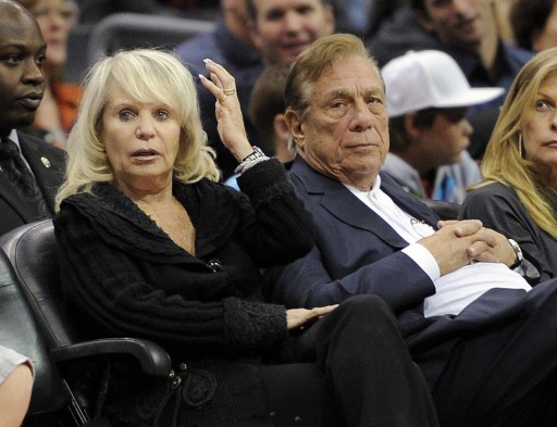 FILE - In this Nov. 12, 2010, file photo, Shelly Sterling sits with her husband, Donald Sterling, right, during the Los Angeles Clippers' NBA basketball game against the Detroit Pistons in Los Angeles. (AP Photo/Mark J. Terrill, File)