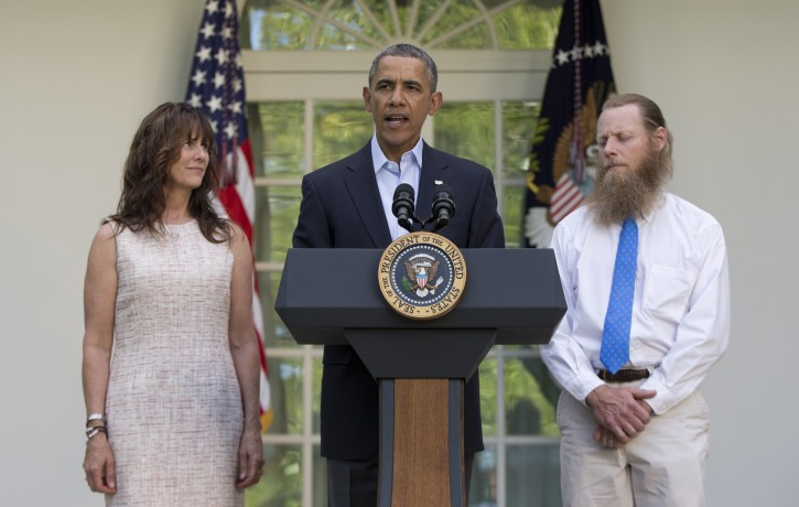 President Barack Obama speaks with Jani Bergdahl, left, and Bob Bergdahl, right, the parents of U.S. Army Sgt. Bowe Bergdahl, in the Rose Garden of the White House in Washington, Saturday, May 31, 2014, after the announcement that Bowe Bergdahl has been released from captivity. Bergdahl, 28, had been held prisoner by the Taliban since June 30, 2009. He was handed over to U.S. special forces by the Taliban in exchange for the release of five Afghan detainees held by the United States. (AP Photo/Carolyn Kaster)