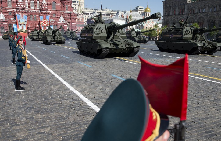 Russian army howitzers move along Red Square during the Victory Day Parade, which commemorates the 1945 defeat of Nazi Germany in Moscow, Russia, Friday, May 9, 2014. Thousands of Russian troops march on Red Square in the annual Victory Day parade in a proud display of the nation's military might amid escalating tensions over Ukraine.  (AP Photo/Pavel Golovkin)