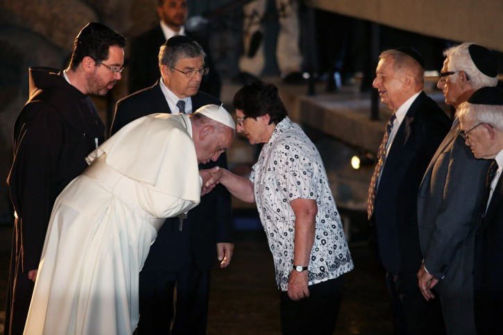 Pope Francis (3-L) kisses the hand of Holocaust Survivor Chava Shik (4-R) during a memorial ceremony in the Hall of Remembrances in the Yad Vashem Holocaust memorial in Jerusalem, Israel, 26 May 2014. Pope Francis honored the six-million Jews who perished at the hands of the Nazis during the Holocaust of World War II. Pope Francis is on a two days visit in Israel.  EPA/ABIR SULTAN