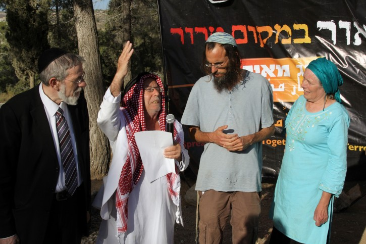 Jews and Muslims pray together for the return of three kidnapped Jewish teenagers, on June 17, 2014, Near the jewish settlement of Gva'ot. Photo by Gershon Elinson/Flash90