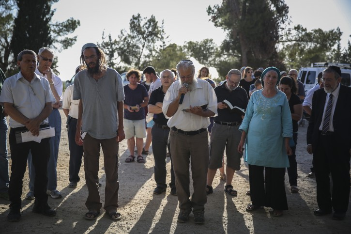 Jewish and Muslim members of the 'Tag Meir' movement conduct a group prayer for the return of three kidnapped Jewish teenagers, on June 17, 2014, near the Jewish settlement of Gva'ot. Photo by Hadas Parush/Flash90