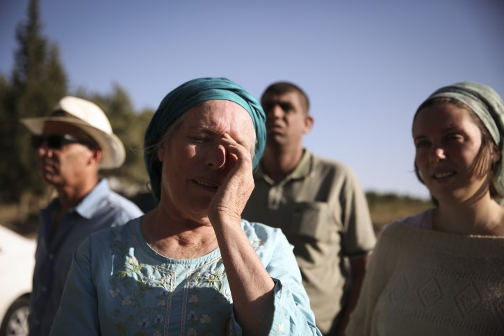 Hadasa Fruman, wife of the late peace activist, Rabbi Menachem Fruman, prays together with Jewish and Muslim members of the 'Tag Meir' movement for the return of three kidnapped Jewish teenagers, on June 17, 2014, near the Jewish settlement of Gva'ot. Photo by Hadas Parush/Flash90