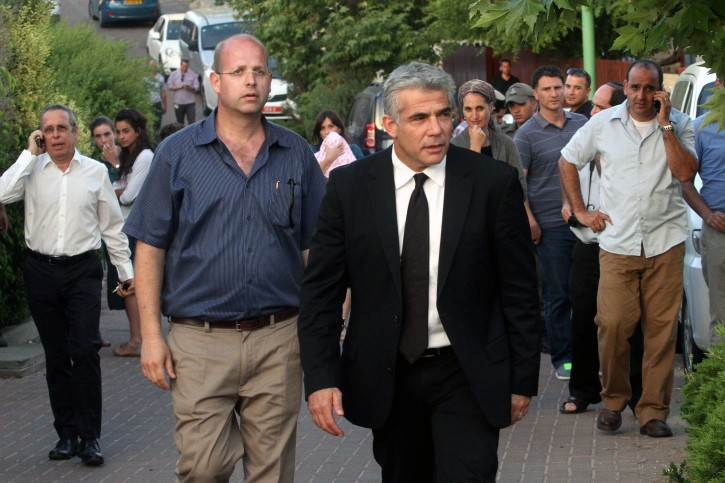 Israel Minister of Finance Yair Lapid arrive to visit the parents of missing Israeli teen, Gilad Sha'ar in Talmon, on June 18, 2014.  Flash90
