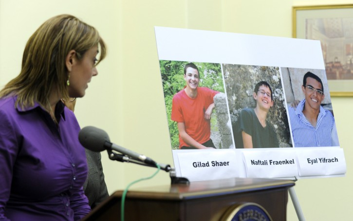 FILE - In this Tuesday, June 24, 2014 file photo, Leehy Shaer, the aunt of kidnapped Israeli-American teen Naftali Frenkel, looks over at a photo of the three missing teens during a news conference on Capitol Hill in Washington.