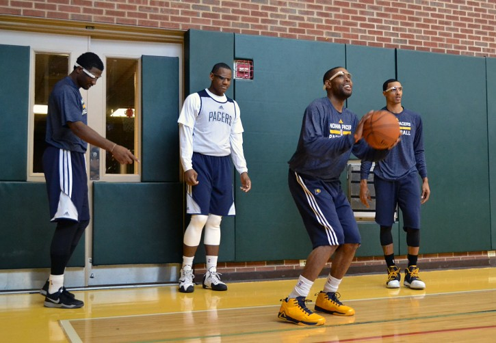 In this March 25, 2014 photo provided by Pacers.com, Indiana Pacers basketball players, from left,  Solomon Hill, Lavoy Allen, C.J. Watson and George Hill wear Google glasses during practice at Bankers Life Fieldhouse in Indianapolis. Google Glass is slowly becoming more common in sports as teams and broadcasters try to bring fans closer to the action. (AP Photo/Pacers.com, Celeste Ballou)