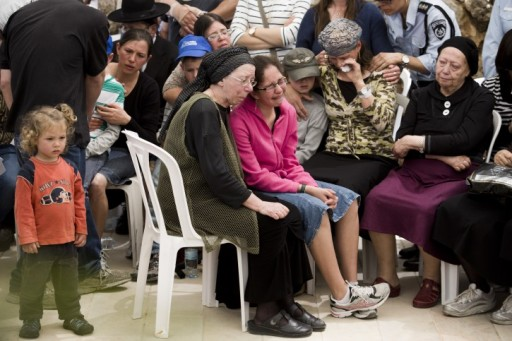 Hadas Mizrahi (C) the widow of Israeli police officer Baruch Mizrahi, 47, is surrounded by family and close friends, during the funeral of her husband at the military cemetery of Mount Herzl in Jerusalem, Israel, 16 April 2014. EPA/ABIR SULTAN