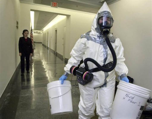 File photo of  biohazard worker prepares to enter the office in the Longworth House office building on Capitol Hill in Washington. (Photo AP)