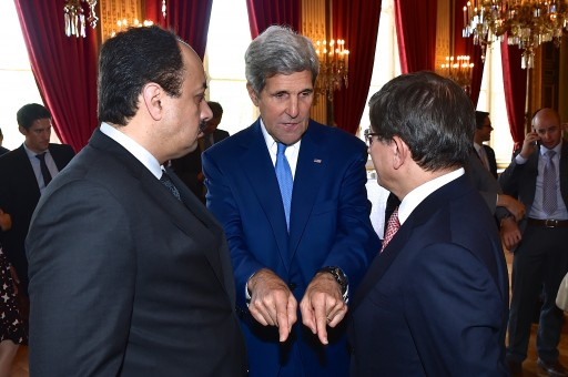 FILE - U.S. Secretary of State John Kerry chats with Qatari Foreign Minister Khalid Al Attiyah and Turkish Foreign Minister Ahmet Davutoglu at the Quai d'Orsay in Paris, France, on July 26, 2014, after a group meeting about a cease-fire in the fighting between Israel and Hamas in the Gaza Strip. [State Department photo/ Public Domain]