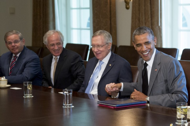 President Barack Obama, right, shakes hands with Senate Majority Leader Harry Reid, a Democrat from Nevada, during a meeting with members of Congress on foreign policy including Senator Robert Menendez, a Democrat from New Jersey, from left, and Senator Bob Corker, a Republican from Tennessee, in Cabinet Room of the White House in Washington, DC, USA, on 31 July  2014.  EPA/Andrew Harrer / POOL