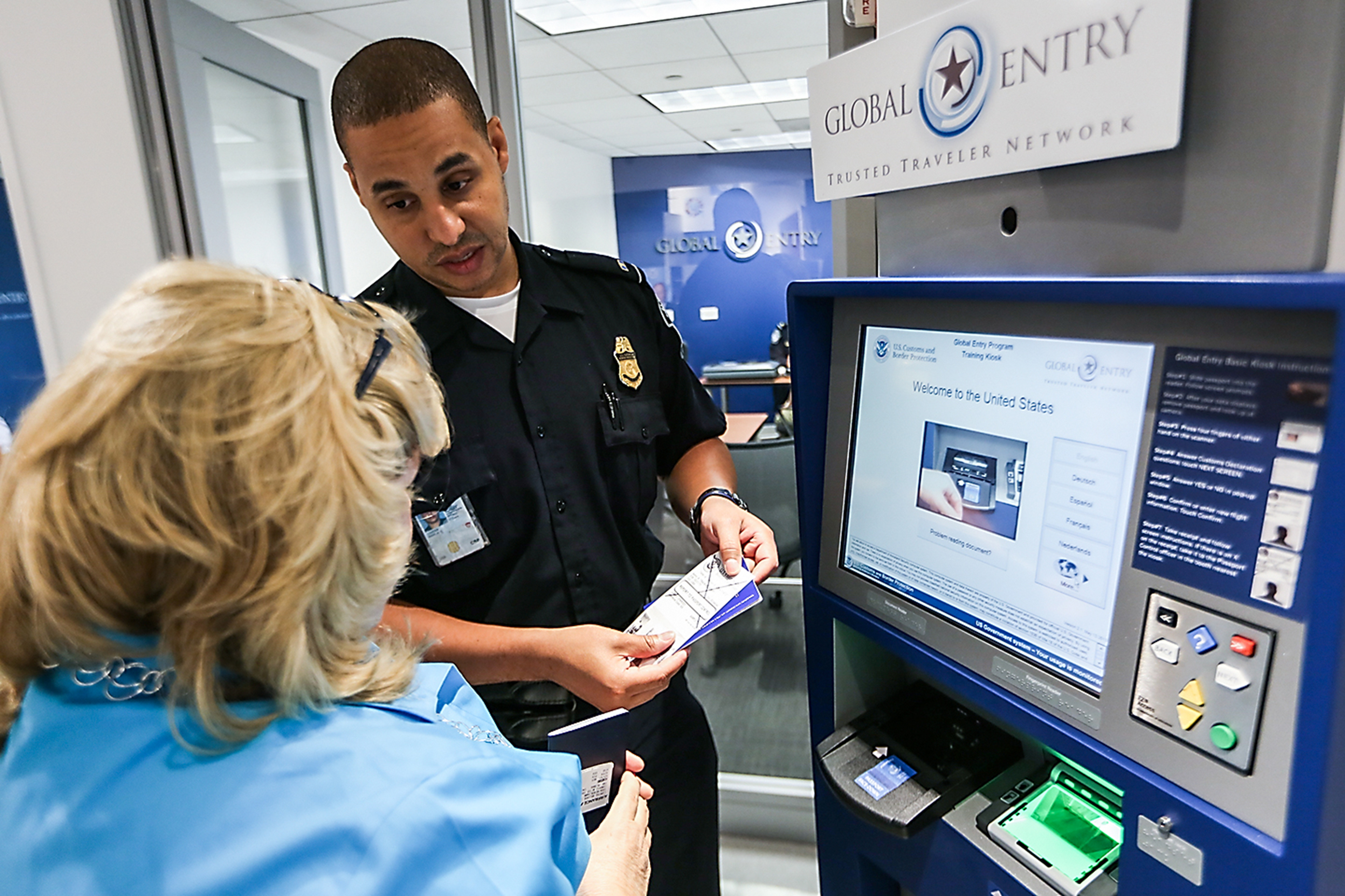 A Cbp Officer Provides Training To An Enrollee With The Use Of A Global  Entry Kiosk