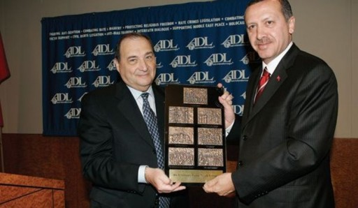 File Photo: Prime Minister Tayyip Recep Erdogan of Turkey, right, also received The Courage to Care award from Abraham Foxman, national director of the Anti-Defamation League, in New York, June 10, 2005. (AP Photo/Richard Drew)