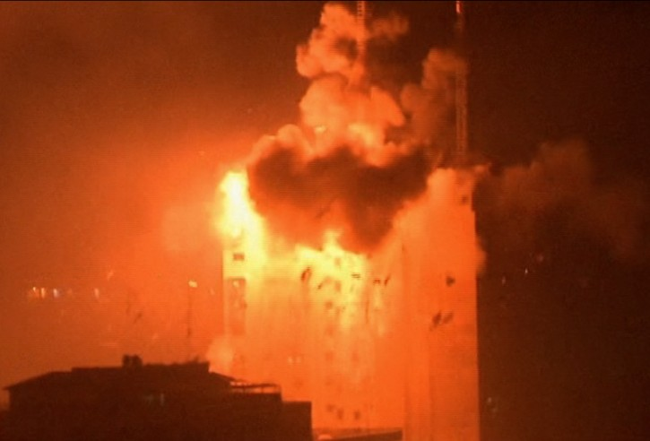 In this image taken from video an explosion hits the media complex that houses the offices of Hamas-run Al Aqsa television and radio in central Gaza City early on Tuesday, July 29, 2014. (AP Photo/APTN)