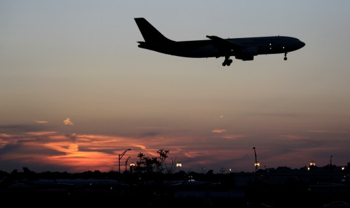 FILE- In this April 25, 2012, file photo, an airplane lands at Newark Liberty International Airport in Newark. (AP Photo/Julio Cortez, File)