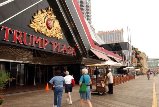 FILE - In this July 8, 2006 file photo, pedestrians enter the Trump Plaza in Atlantic City, N.J. The rapid disintegration of Atlantic City's casino market might be an early indicator of what could happen in other parts of the country that have too many casinos and not enough gamblers.  (AP Photo/Mary Godleski, File)