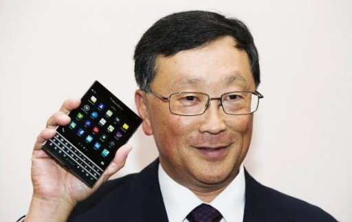Chief Executive Officer of BlackBerry Ltd John Chen holds up the unreleased Blackberry Passport device at their annual general meeting for shareholders in Waterloo in this file photo taken June 19, 2014.  REUTERS/Mark Blinch/Files