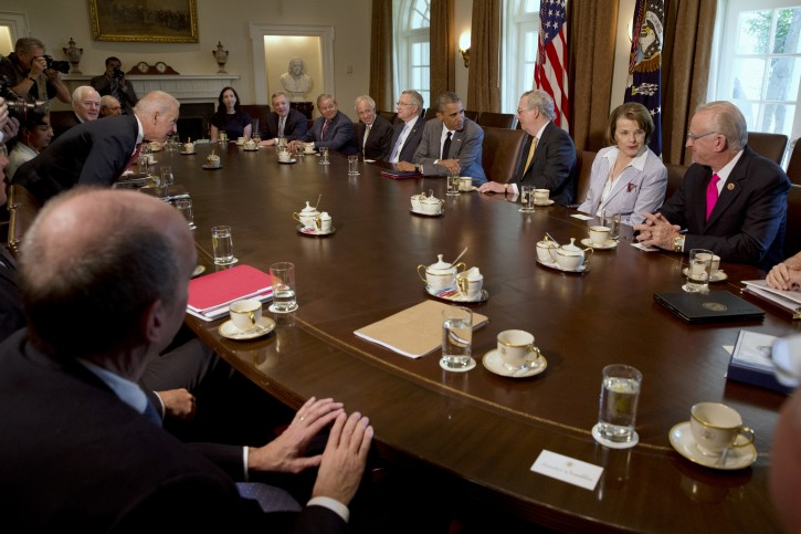 President Barack Obama meets with Congressional leaders to discuss foreign policy, Thursday, July 31, 2014, in the Cabinet Room of the White House in Washington. Clockwise from center left, Vice President Joe Biden, National Security Adviser Susan Rice, Senate Minority Whip John Cornyn of Texas, Senate Armed Service Committee Chairman Sen. Carl Levin, D-Mich., White House Legislative Affairs Director Katie Beirne Fallon, Senate Majority Whip Richard Durbin of Ill., Foreign Relations Committee Chairman Sen. Robert Menendez, D-N.J., Foreign Relations Committee ranking member Sen. Bob Corker, R-Tenn., Senate Majority Leader Harry Reid of Nev., the president,  Senate Minority Leader Mitch McConnell of Ky., Senate  Intelligence Chair Sen. Dianne Feinstein, D-Calif., and House Armed Services Committee Chairman Rep. Buck McKeon, R-Calif.  (AP Photo/Jacquelyn Martin)