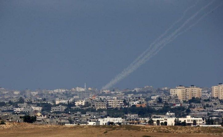 Smoke trails are seen as rockets are launched towards Israel from northern Gaza July 9, 2014.  EPA