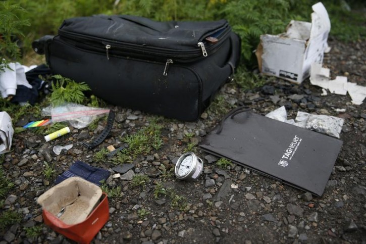 Personal belongings from a Malaysian Airlines Boeing 777 plane which was downed on Thursday are seen near the village of Rozsypne, in the Donetsk region July 18, 2014.