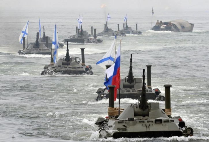 Russian amphibious vehicles move during a naval parade rehearsal in the far eastern port of Vladivostok, July 25, 2014. Reuters